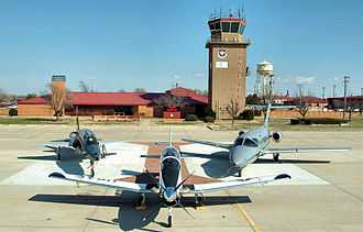 71st Operations Group - Aircraft of the 71st Operations Group. From left: A T-38 Talon, T-6A Texan II, and a T-1 Jayhawk are posed in front of the base control tower on the Vance flightline.