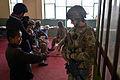 755th ESFS airman meets with Afghan school children near Bagram.jpg
