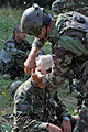 A Slovenian army engineer bandages a simulated casualty after a mock attack from U.S. Soldiers with the 1st Battalion, 4th Infantry Regiment at Hohenfels Training Area, Germany, Sept 140904-A-ZZ999-010.jpg