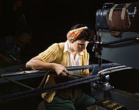 A girl riveting machine operator at the Douglas Aircraft Company plant joins sections of wing ribs.jpg