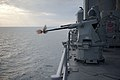 A machine gun aboard USS Pearl Harbor fires rounds during a live-fire exercise. (6807746655).jpg