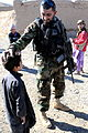 A soldier with the Afghan National Army's 9th Commando Battalion (Kandak) speaks with a boy during a humanitarian assistance mission in the Herat district, Herat province, Afghanistan, Dec. 3, 2011 111203-A-ON828-006.jpg