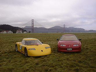AC Propulsion - Yellow AC Propulsion tzero and red General Motors EV1