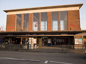 Acton Town tube station - View of the station with its distinguishing architecture. Note the famous London Underground Roundel sign sitting on the flat canopy.