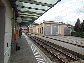 Agno railway station - The station platform looking north, with station building to left and depot entrance to right