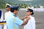 Air Chief Marshal Arup Raha awarding 'Flag Officer Commanding-in-Chief (South) Gold Medal' for being adjudged the best female trainee to Cadet Surabhi Chopra.jpg
