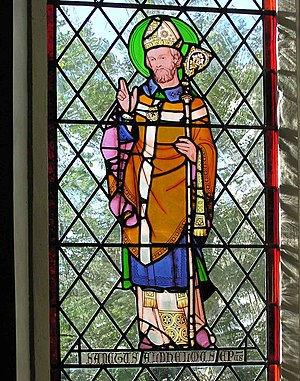 Stained glass window showing St Aldhelm, in Ma...