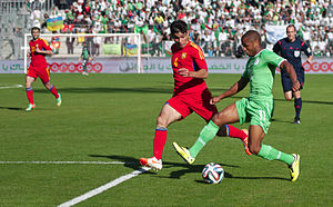 Yacine Brahimi - Brahimi in a May 2014 friendly, attacking against Taron Voskanyan of Armenia