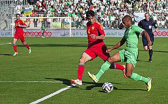 Yacine Brahimi - Brahimi in a May 2014 friendly, attacking against Taron Voskanyan of Armenia