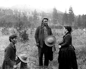 Chief Joseph - An 1889 photograph of Joseph speaking to ethnologist Alice Cunningham Fletcher and her interpreter James Stuart