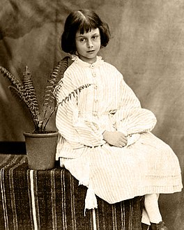 Alice Liddell, age 7, photographed by Charles Dodgson (Lewis Carroll) in 1860.