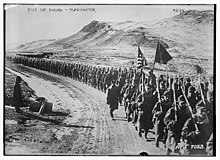 Black and white photo of soldiers marching