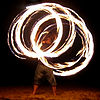 Description: A fire twirler with staff Source: Eng...