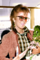 Anni-Frid Lyngstad at Schiphol 1982 colourised.png