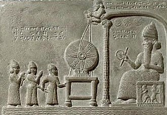 Measuring rod - The sun-god Shamash holding a ring of coiled rope and a rod