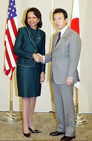 Tarō Asō - Tarō Asō shakes hands with then Secretary of State of U.S. Condoleezza Rice at APEC summit in 2005