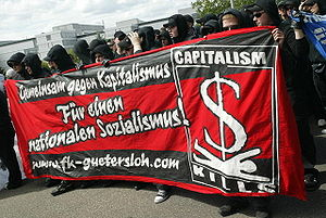 Autonome Nationalisten - Autonome Nationalisten with an anti-capitalist banner, wearing clothing typical of left-wing black blocs.