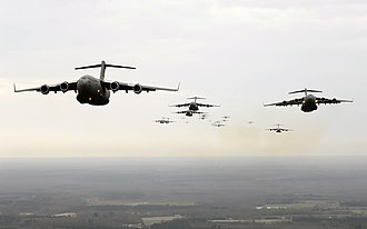Military aviation - A squadron of USAF C-17A transports on an air drop operation