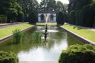 Ayscoughfee Hall - Ayscoughfee Hall Gardens; the building at the head of the pool is Spalding War Memorial.