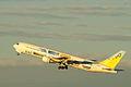 B767-300 ER take off in sunset (Tokyo international airport RWY 34R) (264808969).jpg