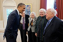 President Barack Obama greets 2010 Fermi Award recipients Dr. Mildred S. Dresselhaus and Dr. Burton Richter in the Oval Office, May 7, 2012