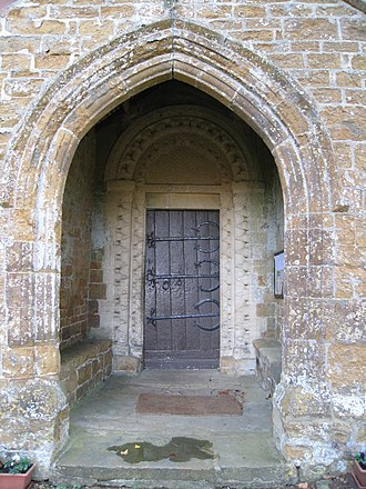 Barford St. Michael - North door of St Michael's church: Norman doorway within Gothic porch