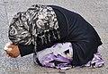 Beggar on the Avenue des Champs Elysees, Paris 2010 (cropped).jpg