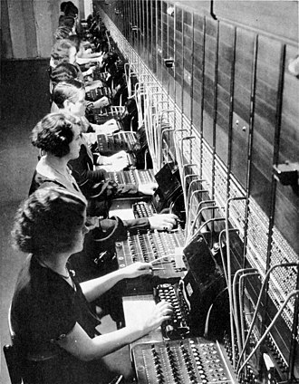 Women in computing - A group of operators working on an AT&T telephone switchboard