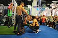 Bench press exercises at the FIBO 2019 in Cologne, Germany (47952479111).jpg