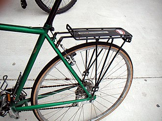 Luggage carrier - A rear rack mounted on a bicycle for road use.