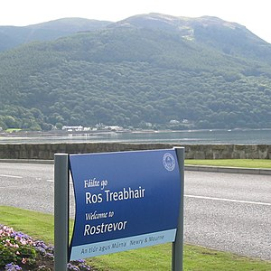 Rostrevor - Rostrevor welcome sign in Irish and English, with Slieve Meen in the background