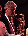 Bill Clinton saxophone 8a9e10f958efc78651fa4c9fb6228e2e (cropped).jpg