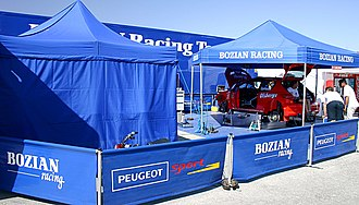 Bozian Racing - Bozian Racing and Daniel Carlsson's Peugeot 206 WRC at the 2005 Cyprus Rally.
