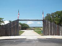 Wooden gateway open to the ocean