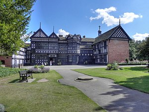 Bramall Hall - Bramall Hall from the west, the side of the main entrance, showing the courtyard and the north and south wings. The Great Hall is in the centre.