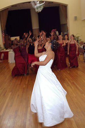 A bride tossing her bouquet of flowers. Catego...
