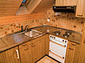 Brown wood kitchen in attic.jpg