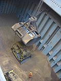 Bulldozer loaded on bulk carrier.jpg