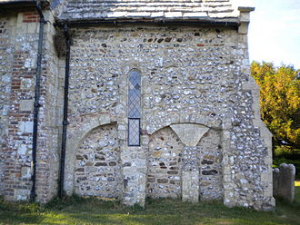 All Saints Church, Buncton - Decorative blocked arches on the chancel wall