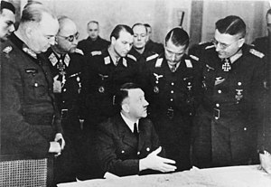 Battle of Halbe - Generaloberst Theodor Busse (standing, far right) in a meeting with Adolf Hitler, March 1945