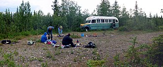 Stampede Trail - Hikers take a break at Bus 142 on the Stampede Trail.