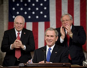 2006 State of the Union Address - President George W. Bush listening to applause while delivering the 2006 State of the Union address. Standing behind Bush, Vice President Richard B.Cheney and House Speaker Dennis Hastert.