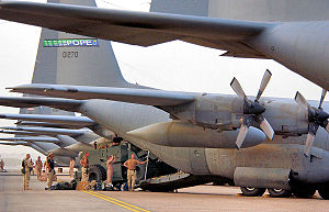 I Troop Carrier Command - Members of the 778th Expeditionary Airlift Squadron, Pope Air Force Base, N.C., and members of the Global Mobility Assessment Team, 621st Air Mobility Group, McGuire AFB, N.J., load a forklift onto a C-130 Hercules in support of Operation Iraqi Freedom in 2006