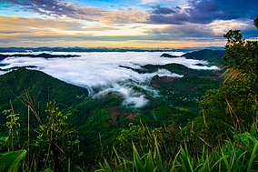 "The sunrise seen from the top of Khao Thevada (""Angel Mountain""; 1,123 m, 3,684 ft)"