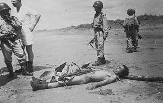 Liberal democracy period in Indonesia - A dead militant following a 1956 attack against a rubber plantation.