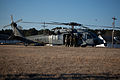 Canadian soldiers with 2nd Battalion, Royal Newfoundland Regiment, 37th Canadian Brigade Group, load onto an MH-60 Seahawk helicopter during Exercise Southern Raider 13, at Fort Pickett, Va., March 4, 2013 130304-A-KH856-057.jpg
