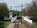 Car crosses the Seaton tramway at Colyford - geograph.org.uk - 1285526.jpg