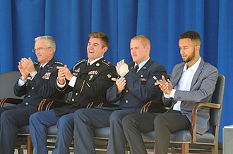 Alek Skarlatos - United States Defense Secretary Ash Carter awards the United States Army Soldier's Medal to Skarlatos (second from the left), an army specialist; the United States Air Force Airman's Medal to Spencer Stone (third from left), an airman first class and the United States Department of Defense Medal for Valor to Anthony Sadler (fourth from left), at a ceremony in The Pentagon courtyard on September 17, 2015.