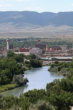 Overview of downtown Casper, looking south toward Casper Mountain, with North Platte River in foreground.