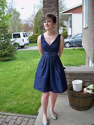 Semi-formal - A woman wearing a cocktail dress which can be considered semi-formal